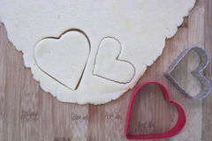 Sugar cookie dough with heart shaped cookie cutters Royalty Free Stock Images
