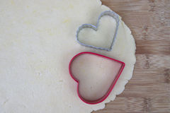 Sugar cookie dough with heart shaped cutters Stock Images
