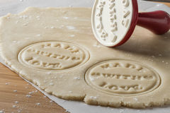 Sugar Cookie Dough. Rolled sugar cookie dough cut out and stamped `Made with Love royalty free stock image