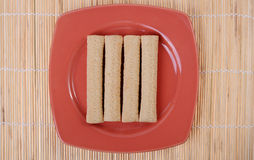 Sugar cookie and a plate on a bamboo Stock Photos