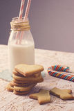 Sugar cookies and bottle of milk and lollipop and broken cookie stock images