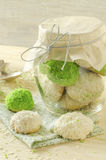 Sugar cookies with coconut flakes in glass jar Stock Image