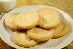 Sugar Cookies. Fresh right out of the oven sugar cookies and a glass of milk royalty free stock photo