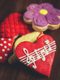 Sugar cookies with glaze, heart with musical notes Royalty Free Stock Photo