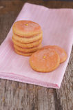 Sugar cookies with pink frosting on old wooden background Royalty Free Stock Photos