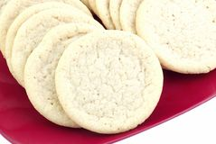 Sugar Cookies on Red Plate Royalty Free Stock Images