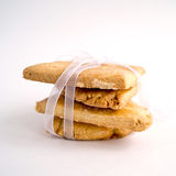 Sugar cookies. Tied with a white ribbon on white background Royalty Free Stock Photos