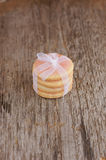 Sugar cookies with white satin tape on old wood Royalty Free Stock Images