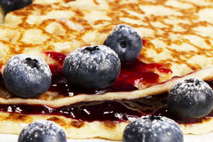 Sugar covered blueberries with jam on pancakes Stock Photos