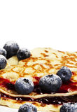Sugar covered blueberries on pancakes Royalty Free Stock Photo