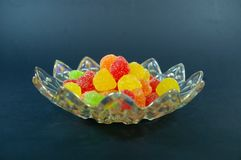Gummies candy plate a black background. Sugar covered gummies candyin a plate on a black background Royalty Free Stock Photography