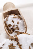 Sugar and crushed cinnamon on a wooden shovel Royalty Free Stock Photos