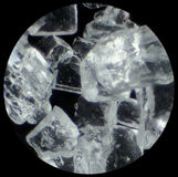 Sugar crystals in microscope Royalty Free Stock Image