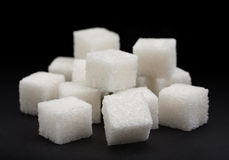 Sugar cube. Ingredient closeup view on dark background Royalty Free Stock Image