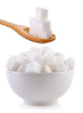 Sugar cube in the bowl and wood spoon Stock Images