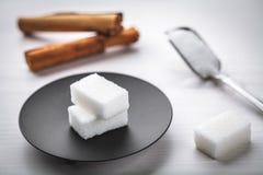 Sugar cube and cinnamon Royalty Free Stock Photos