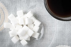 Sugar cube with coffee Royalty Free Stock Photo