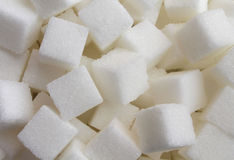 Sugar Cube. Food ingredient background with a close up of a pile of sweet white lumps of cubes as a symbol of cooking and baking and the diet health risks Stock Image