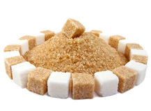 Sugar cube. On a heap of granulated sugar Royalty Free Stock Photos