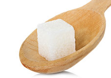 Sugar cube in spoon Royalty Free Stock Image