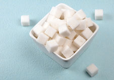 Sugar cubes. Pile of sugar cubes on bowl Stock Photography