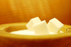 Sugar Cubes. White sugar cubes in a contrasting orange bowl Stock Image