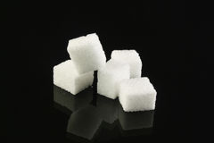 Sugar cubes. On a black background Stock Photo
