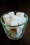 Sugar cubes. In a small transparent cup Royalty Free Stock Photo