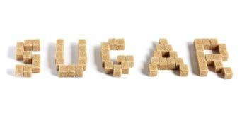 Sugar cubes. Word sugar made up of brown sugar cubes Stock Image