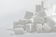 Sugar cubes. Close up on the stack of white sugar cubes stock images