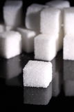 Sugar cubes A. Photograph of sugar cubes on a black background Royalty Free Stock Photography