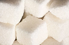 Sugar cubes. Several pieces of refined sugar Stock Photos