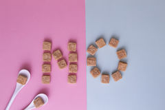 Sugar cubes arranged as word NO. Top view. Diet unhealty sweet addiction diabet concept Royalty Free Stock Photos