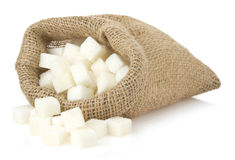 Sugar cubes in bag sack. On white background Royalty Free Stock Photos