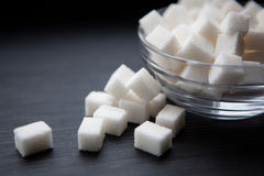 Sugar cubes on black background, close up Stock Photos