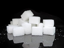 Sugar cubes on black background Stock Image
