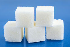 Sugar cubes on blue Stock Images