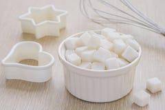 Sugar cubes in bowl Stock Photos