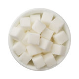 Sugar cubes in a bowl isolated on white background Stock Images