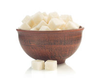 Sugar cubes in bowl isolated on white Stock Photos