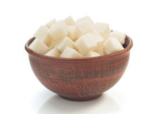 Sugar cubes in bowl isolated on white Royalty Free Stock Photos