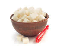Sugar cubes in bowl isolated on white Royalty Free Stock Images