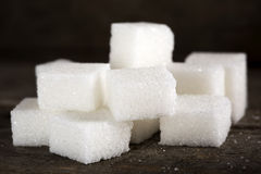 Sugar cubes. Close-up of some sugar cubes over wooden table stock photos