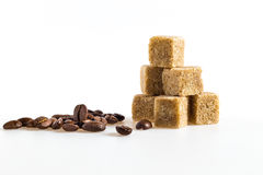Sugar cubes and coffee bean Stock Images