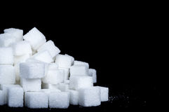 Sugar Cubes. In front of black background Royalty Free Stock Images