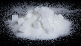 Sugar. Cubes and  in front of black background Stock Photography