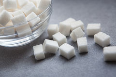 Sugar cubes on gray background Stock Image