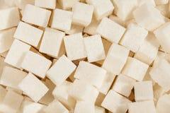 Sugar cubes. Many closeup background above Stock Photo