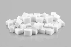 Sugar cubes. Pile of sugar cubes isolated on gray  background Royalty Free Stock Photos