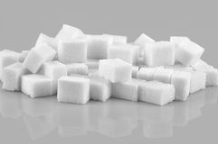 Sugar cubes. Pile of sugar cubes isolated on gray  background Royalty Free Stock Images